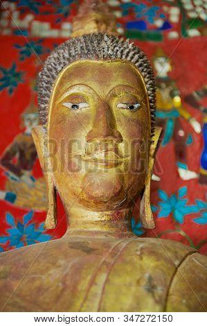 Luang Prabang, Laos - April 16, 2012: Buddha Image In A Small Red Color Hall Of Wat Xieng Thong Or T
