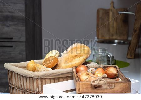 Muffin Lies In The Kitchen In A Small Basket, Loaves, Bread And Rolls. Bad Food, Fullness, Copy Spac
