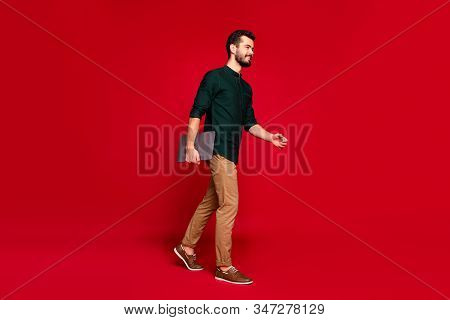 Full Length Profile Side Photo Of Positive Charming Guy Go Walk Work Enterprise Hold Computer Feel H