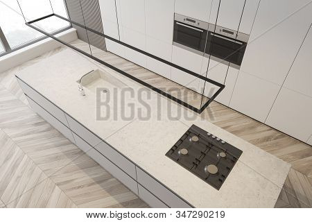 Top View Of Modern Kitchen With Gray And White Walls, Wooden Floor, White Countertops With Built In