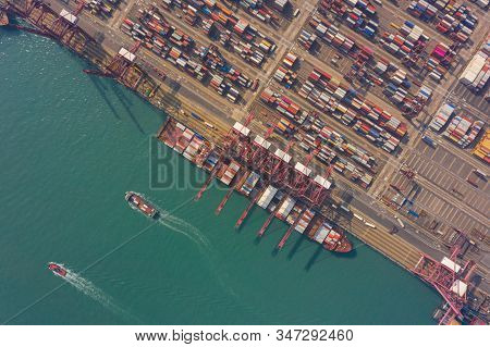 Aerial View Of International Port With Crane Loading Containers In Import Export Business Logistics