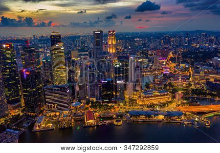 Aerial View Of The Singapore Landmark Financial Business District At Sunset Scene With Skyscraper An