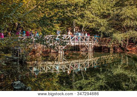 Bolu, Turkey - October 12, 2019: Tourists On Wooden Bridge At Yedigoller National Park On A Sunny Da