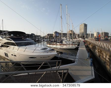 Ostend, Belgium - 7 August 2018: Pleasure Boats In The Marina Mercator With Several Apartment Buildi