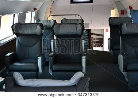 Seats In The Cabin Of The 1st Business Class Carriage Of A Passenger High Speed Train. Interior Of T