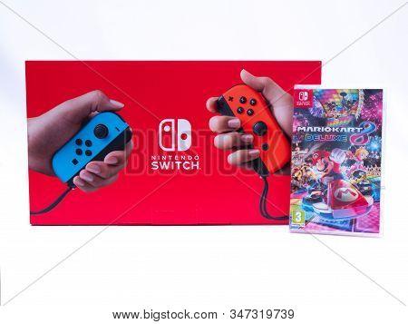 Uk, Jan 2020: Nintendo Switch Games Console Box With Mario Kart Game Bundle On White Background
