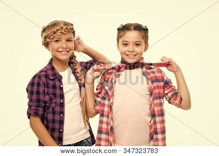Haircare Begins With Natural Products. Happy Children Hold Long Hair Braids. Haircare And Hairstylin
