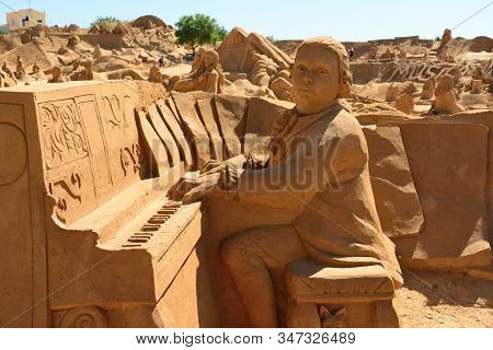 Pera.algarve.portugal.june 17th 2016.a Sand Sculpture Of Mozart Playing The Piano  Is On Display At