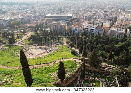 Aerial View From The Acropolis Of Athens To The Ruins Of The Theater Of Dionysus And The City.