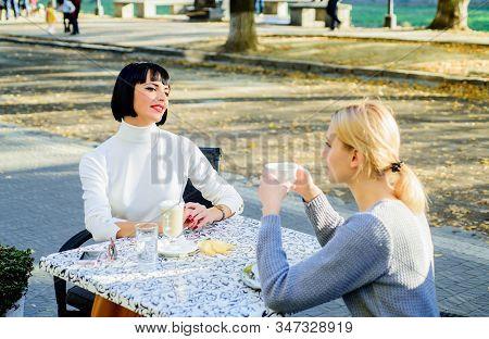 Friendship Meeting. Female Friendship. Trustful Communication. Girls Friends Drink Coffee And Talk.