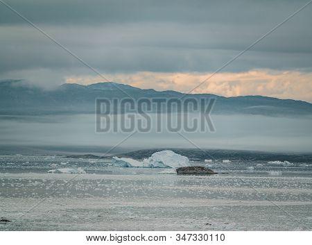 Greenland Glacier With Sea Ice And A Glacial Landscape Near The Eqip Sermia Glacier, Eqi In Western