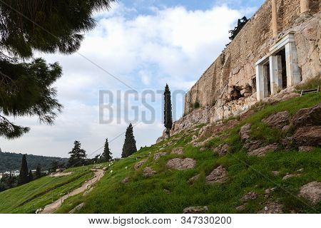 Choregic Monument Of Trasil. In The Upper Part Of The Theater Of Dionysus, There Is A Small Grotto,