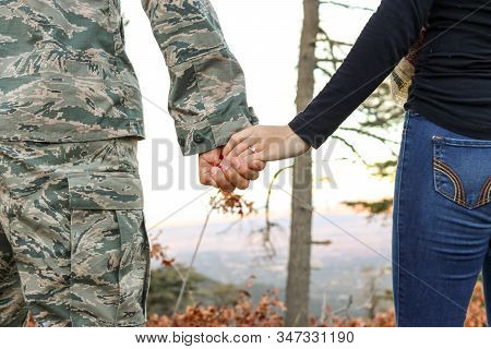 A Soldier Holding His Wife Hand. Us Military Couple Holding Hands. This Image Was Taken On Dallas, T