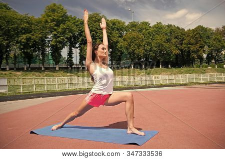 Woman Healthy Body Practice Yoga Outdoors Nature Background. Girl Stretching Workout. Stretching Mus