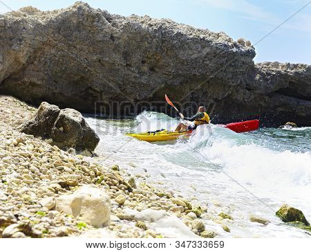 Summer Travel Kayaking. Man Paddling Canoe Kayak Enjoying Recreational Sporting Activity. Male Canoe