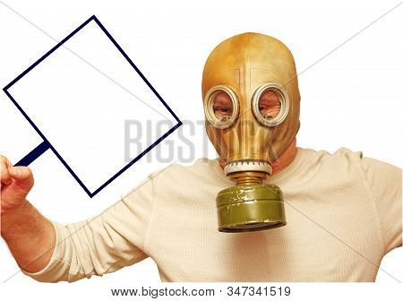 Stop Corona Virus concept. Man in gas mask showing placard with empty space isolated on white background.