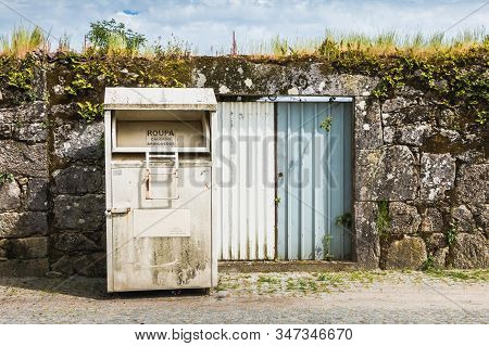 Vila Cha Near Esposende, Portugal - May 9, 2018: Public Containers For Retrieving Toy And Clothes (r