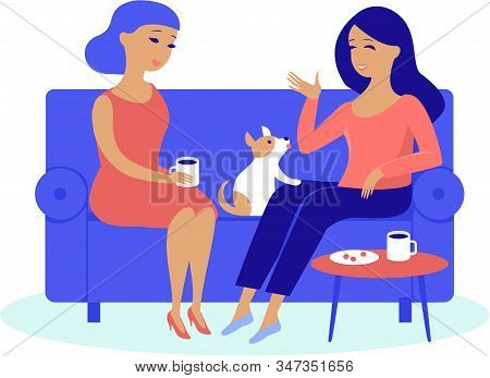 Young Women Friends Having Cosy Conversation Drinking Coffee Or Tea At Home