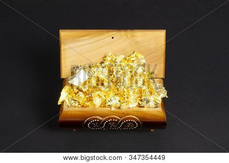 Opened Single Casket With Golden Foil As Gold Inside On The Dark Paper Background, Wooden Box, Woode