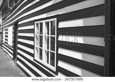 Black And White Striped Building, House With A Difference, On Street Frontage.