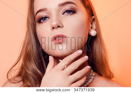 Incredible Beautiful Girl With Creative Make-up With Pearls. Pearl Earrings And A Necklace, Art Make