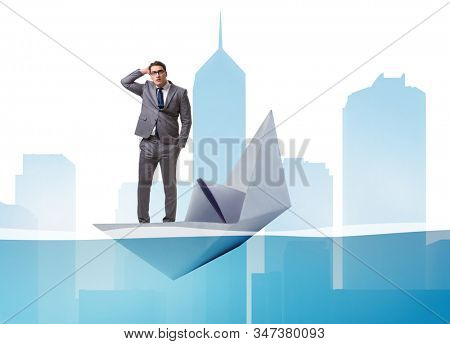Businessman escaping sunken paper boat ship