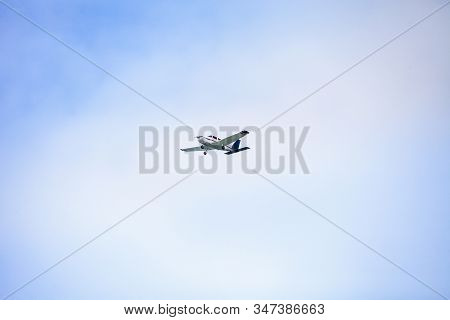 Small Cessna 172 Airplane Soars Through Blue Sky Over The Southwestern Part Of Florida.