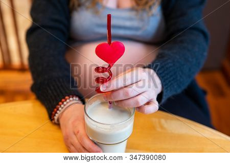 A Close Up Shot Of A Woman In Third Trimester Of Pregnancy With Blurry Baby Bump Enjoying A Healthy