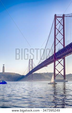 Amazing Image Of Lisbon 25th April Bridge (ponte 25 De Abril). Taken From Alfama. Vertical Image