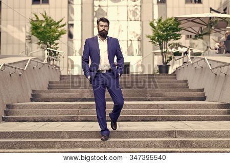 Business Man In Modern City. Beginning Of Working Day. Office Worker Confidently Step On Stairs. Fou