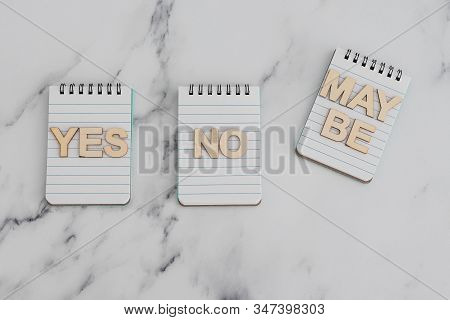 Making A Choice And Facing Doubts, Notepads With Yes No And Maybe Options
