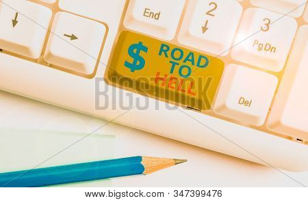 Handwriting text Road To Hell. Concept meaning Extremely dangerous passageway Dark Ri Unsafe travel White pc keyboard with empty note paper above white background key copy space. poster