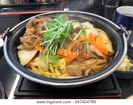 Japan Cuisine, Soup With Sliced Pork, Udon, Vegetable In Hot Pot