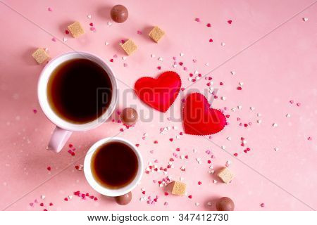 Love Drinks. Coffee Tea Cups For Lovers, Sweets Candy Chocolate On Pink Hearts Background. Valentine