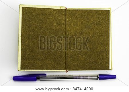 Open Book With A Brown Spread For The Mocap Frame At The Bottom Is The Fountain Pen