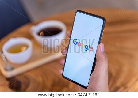 Chiang Mai, Thailand - Jan.18,2020: Man Holding Xiaomi Mi Mix 3 With Google Search On Screen. Google