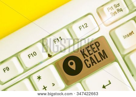 Writing note showing Keep Calm. Business photo showcasing not get emotionally invested in situations you cannot control over White pc keyboard with note paper above the white background. poster