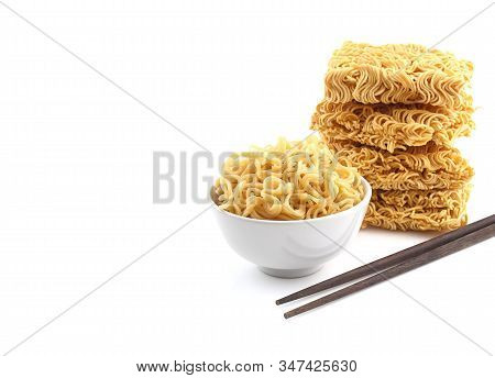Bowl Of Noodles  And Heap Of Dry Noodle With Chopsticks