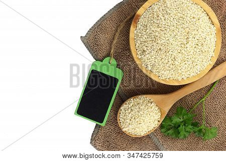 Top View - White Sesame Seeds In Bowl  And Blank Wooden Tag