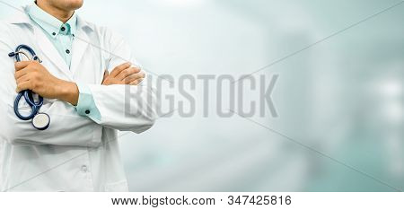 Male Doctor Standing In The Hospital Office.