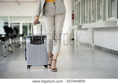 Business Woman Dragging Suitcase Luggage Bag,walking To Passenger Boarding In Airport.working Young