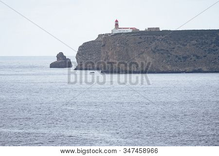 Lighthouse At The Cabo De Sao Vicente In Sagres In Algarve Portugal On Overcast Day