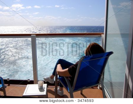 Relaxing Passenger On Stateroom Balcony Aboard Ship On Transatlantic Crossing