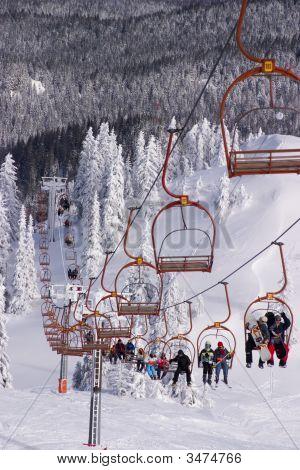 Skiers Riding The Ski-Lift On Jahorina Mountain, Near Sarajevo,
