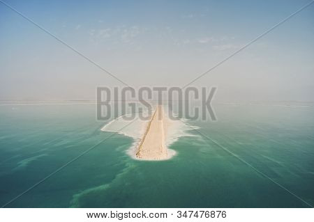 Road On Dead Sea Surface. The Southern Part Of The Dead Sea, Is Divided Into Pools From Which Extrac