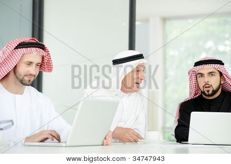 happy Saudi man at work