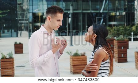 Beautiful Black Woman Accusing Her Husband Of Treason Outdoors. She Pushing Him With Her Hands And G