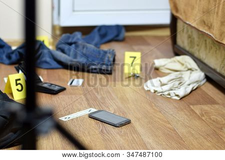Crime Scene Investigation - Numbering Of Evidences After The Murder In The Apartment. Broken Smartph
