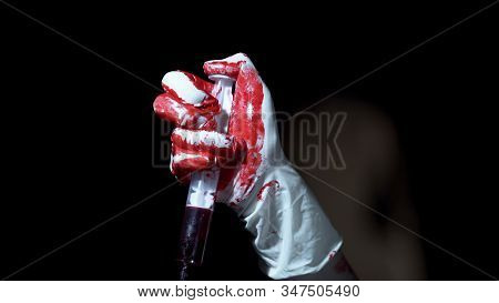 Insane Murderer Holding Syringe With Blood For Making Injection, Terrible View