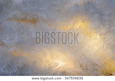 Light Fabric With Lights Between The Folds. Fluffy And Fleecy Warm Fabric. Light Fabric With Lights
